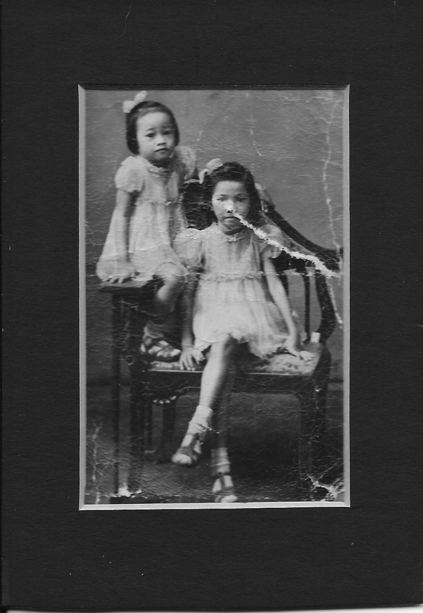 Portrait of my mother and her older sister in the Philippines, December 1945